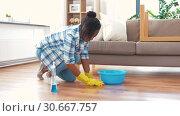 Купить «african woman with sponge cleaning floor at home», видеоролик № 30667757, снято 15 апреля 2019 г. (c) Syda Productions / Фотобанк Лори