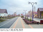 Купить «National Village. Orenburg, Russia - April, 14, 2019: The central street of the cultural and ethnographic complex National Village in spring», фото № 30676501, снято 14 апреля 2019 г. (c) Вадим Орлов / Фотобанк Лори
