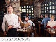 Waitress welcoming in rustic restaurant. Стоковое фото, фотограф Яков Филимонов / Фотобанк Лори