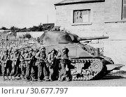 Купить «BELGIUM -- 09 Sep 1944 -- US Army soldiers of 60th Infantry Regiment advance into a Belgian town under the protection of a heavy tank -- Picture by Spangle...», фото № 30677797, снято 23 мая 2012 г. (c) age Fotostock / Фотобанк Лори