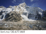 Купить «NEPAL Khumbu Glacier -- Dec 2005 -- The top of the Khumbu Glacier, a popular climbing route to the summit of Mount Everest (upper left) this glacier has...», фото № 30677869, снято 17 июля 2019 г. (c) age Fotostock / Фотобанк Лори