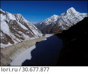 Купить «NEPAL Trakarding Glacier -- 16 Apr 2005 -- Aerial view of Tsho Rolpa - a glacial lake at the foot of the Trakarding Glacier, which is remarkable as it...», фото № 30677877, снято 23 мая 2019 г. (c) age Fotostock / Фотобанк Лори