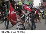 Купить «NEPAL Kathmandu -- A Maoist trade union march in Thamel, Kathmandu, Nepal -- Picture by Jon Mitchell | Lightroom Photos.», фото № 30678053, снято 27 июня 2019 г. (c) age Fotostock / Фотобанк Лори