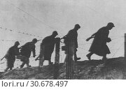 Купить «RUSSIA Stalingrad -- 1941 -- Russian sappers of the Red Army crossing area through barbed wire barriers in Leningrad Russia during World War II. It developed...», фото № 30678497, снято 1 апреля 2020 г. (c) age Fotostock / Фотобанк Лори