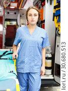 Купить «Female doctor standing in ambulance auto», фото № 30680513, снято 30 ноября 2018 г. (c) Яков Филимонов / Фотобанк Лори