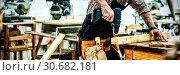 Купить «Carpenter working on his craft», фото № 30682181, снято 23 октября 2019 г. (c) Wavebreak Media / Фотобанк Лори