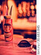 Купить «Close up of bar accessories with moai mug», фото № 30683845, снято 16 октября 2019 г. (c) Wavebreak Media / Фотобанк Лори