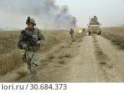 Купить «IRAQ Tahwilla -- 30 Jul 2008 -- US Army Sgt Daniel Kear makes his way down a road after canal vegetation is set ablaze in Tahwilla, Iraq. Iraqi insurgents...», фото № 30684373, снято 20 мая 2019 г. (c) age Fotostock / Фотобанк Лори