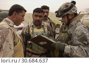 Купить «IRAQ Namla -- 31 Oct 2005 -- US Army 2nd Lt Tom Koh (right) briefs Iraqi Army soldiers about an upcoming mission to conduct a joint foot patrol with U...», фото № 30684637, снято 17 июня 2019 г. (c) age Fotostock / Фотобанк Лори