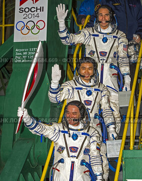 Baikonur Cosmodrome, Kazakhstan. 07 November, 2013. Winter Olympics torch in space.Expedition 38 Soyuz Commander Mikhail Tyurin of Roscosmos, holding the...
