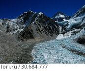 Купить «NEPAL Everest Base Camp -- 16 Apr 2005 -- The massive ice fall which dominates this image is part of the upper Khumbu Glacier. Like on many of the world...», фото № 30684777, снято 20 июля 2019 г. (c) age Fotostock / Фотобанк Лори