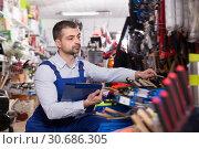 Купить «Portrait of seller male who is making rediscount», фото № 30686305, снято 9 января 2018 г. (c) Яков Филимонов / Фотобанк Лори