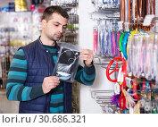 Fisherman customer buying ocean fishing lures in store. Стоковое фото, фотограф Яков Филимонов / Фотобанк Лори
