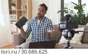 Купить «male blogger with keyboard videoblogging at home», видеоролик № 30686625, снято 26 апреля 2019 г. (c) Syda Productions / Фотобанк Лори