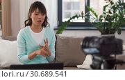 Купить «asian female blogger with camera recording video», видеоролик № 30689541, снято 25 апреля 2019 г. (c) Syda Productions / Фотобанк Лори