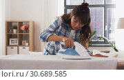 Купить «asian woman ironing bed linen at home», видеоролик № 30689585, снято 25 апреля 2019 г. (c) Syda Productions / Фотобанк Лори