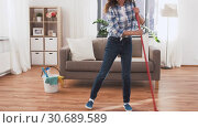 Купить «asian woman with broom sweeping floor and cleaning», видеоролик № 30689589, снято 25 апреля 2019 г. (c) Syda Productions / Фотобанк Лори