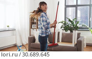 Купить «asian woman with broom sweeping floor and cleaning», видеоролик № 30689645, снято 25 апреля 2019 г. (c) Syda Productions / Фотобанк Лори