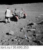 Купить «EARTH The Moon -- 22 Apr 1972 -- Apollo 16 astronaut Charles M Duke Jnr, pilot of the Lunar Module Orion, stands near the Rover, Lunar Roving Vehicle ...», фото № 30690353, снято 21 мая 2019 г. (c) age Fotostock / Фотобанк Лори