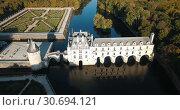 Купить «Aerial view of Chateau de Chenonceau in Loire valley, France», видеоролик № 30694121, снято 25 октября 2018 г. (c) Яков Филимонов / Фотобанк Лори