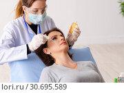 Купить «Woman preparing for cosmetic plastic surgery», фото № 30695589, снято 14 ноября 2018 г. (c) Elnur / Фотобанк Лори