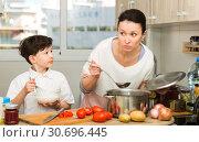 Купить «Woman and her son preparing food», фото № 30696445, снято 28 марта 2019 г. (c) Яков Филимонов / Фотобанк Лори