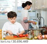 Купить «Boy preparing food with mother», фото № 30696449, снято 28 марта 2019 г. (c) Яков Филимонов / Фотобанк Лори