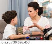 Купить «Mother reprimanding son», фото № 30696453, снято 28 марта 2019 г. (c) Яков Филимонов / Фотобанк Лори