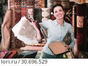 Купить «Female choosing carpet samples», фото № 30696529, снято 22 ноября 2017 г. (c) Яков Филимонов / Фотобанк Лори