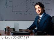 Купить «Financial specialist working late in the office», фото № 30697197, снято 25 октября 2018 г. (c) Elnur / Фотобанк Лори