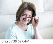 Купить «Portrait of a woman with glasses in home interior», фото № 30697441, снято 1 мая 2019 г. (c) Володина Ольга / Фотобанк Лори