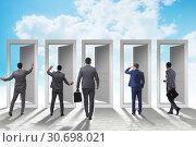 Купить «Businessman in uncertainty concept with many doors», фото № 30698021, снято 18 июня 2019 г. (c) Elnur / Фотобанк Лори
