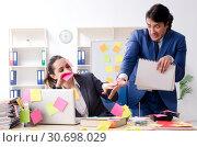 Купить «Two colleagues employees working in the office», фото № 30698029, снято 22 января 2019 г. (c) Elnur / Фотобанк Лори