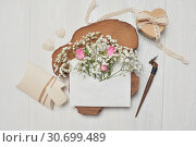 Calligraphic feather an envelope with flowers and a letter, heart gift box, greeting card for Valentines Day with place for your text. Flat lay, top view photo mock up. Стоковое фото, фотограф Happy Letters / Фотобанк Лори