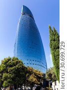 Купить «View of the Fiery Towers. Skyscraper of unusual shape in the center of Baku», фото № 30699729, снято 23 сентября 2018 г. (c) Евгений Ткачёв / Фотобанк Лори
