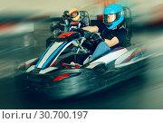 Купить «Glad woman driving sport car in a circuit lap», фото № 30700197, снято 18 марта 2019 г. (c) Яков Филимонов / Фотобанк Лори