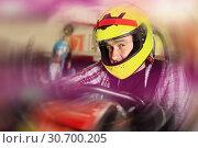 Купить «Portrait of nice man driving racing car», фото № 30700205, снято 18 марта 2019 г. (c) Яков Филимонов / Фотобанк Лори