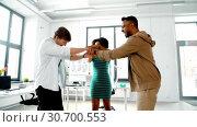 Купить «happy creative team stacking hands at office», видеоролик № 30700553, снято 25 мая 2019 г. (c) Syda Productions / Фотобанк Лори