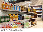 Купить «Shelves with alcohol of different brands in duty free shop at Bangkok airport», фото № 30700565, снято 27 марта 2019 г. (c) Григорий Писоцкий / Фотобанк Лори