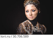 Купить «Portrait a girl with Golden icon painting makeup», фото № 30706589, снято 5 апреля 2019 г. (c) Sergii Zarev / Фотобанк Лори