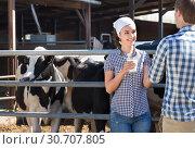 Купить «Portrait of two farm workers holding glass with milk», фото № 30707805, снято 24 августа 2019 г. (c) Яков Филимонов / Фотобанк Лори