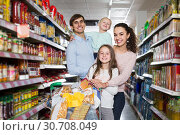 Купить «parents with two kids and purchases in shopping cart», фото № 30708049, снято 25 мая 2019 г. (c) Яков Филимонов / Фотобанк Лори