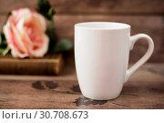 Купить «Mug Mockup. Coffee Cup Template. Coffee Mug Printing Design Template. White Mug Mockup, Old Book and Flower, Wooden Background. Blank Mug. Mockup Styled Stock Product Image», фото № 30708673, снято 29 сентября 2016 г. (c) easy Fotostock / Фотобанк Лори