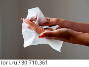 Купить «Cleaning fingers with wet wipes», фото № 30710361, снято 19 августа 2017 г. (c) easy Fotostock / Фотобанк Лори