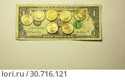 7 gold coins face value of 10 rubles per 1 US dollar rate with currency sign on a white background. Стоковое видео, видеограф Aleksandr Sulimov / Фотобанк Лори