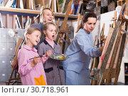 Купить «Skillful woman teacher showing her skills during painting class at art studio», фото № 30718961, снято 21 августа 2019 г. (c) Яков Филимонов / Фотобанк Лори
