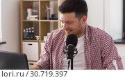 Купить «happy young man with laptop and microphone at home», видеоролик № 30719397, снято 2 мая 2019 г. (c) Syda Productions / Фотобанк Лори