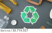 Купить «green recycle symbol with household waste on grey», видеоролик № 30719557, снято 8 мая 2019 г. (c) Syda Productions / Фотобанк Лори