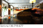 Купить «Pay the bank plastic card through the terminal in the institution», видеоролик № 30719677, снято 2 декабря 2016 г. (c) Aleksandr Sulimov / Фотобанк Лори