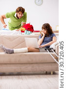 Купить «Husband helping leg injured wife in housework», фото № 30720405, снято 4 октября 2018 г. (c) Elnur / Фотобанк Лори
